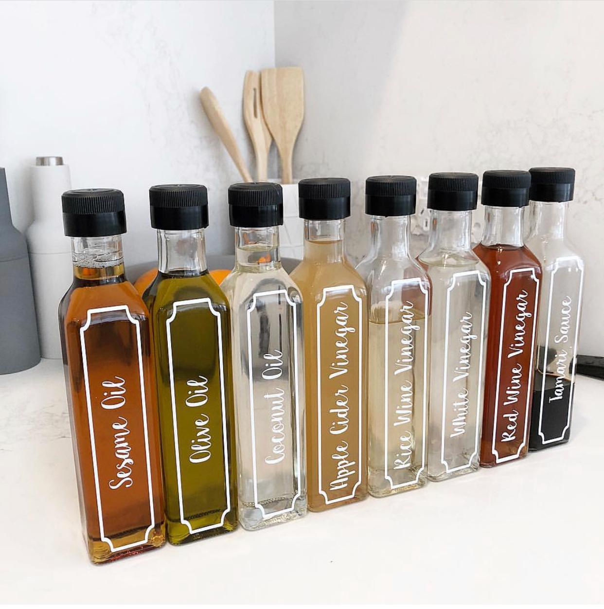 labelled oil and vinegar bottles